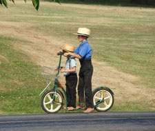 Amish children on scooter